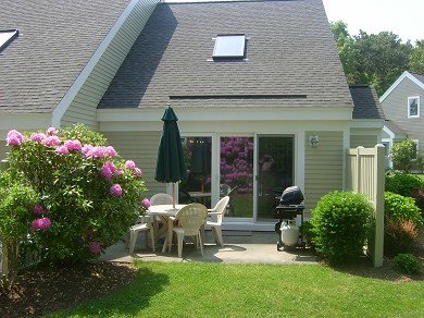 Brewster Cape Cod vacation rental - Patio with gas grill and dining for four.