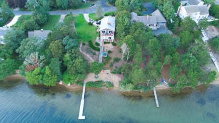 Pleasant Lake Harwich Cape Cod vacation rental - Ariel view of the house, decks, dock and beach