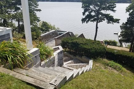 Pleasant Lake Harwich Cape Cod vacation rental - Beautiful backyard leading to overlook deck and private beach