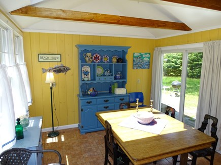 Eastham Cape Cod vacation rental - Sunny dining room with vaulted ceiling, slider to backyard.
