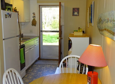 Eastham Cape Cod vacation rental - Kitchen in cottage opens to spacious back yard