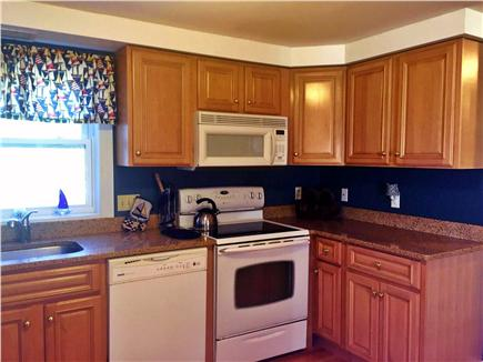 Hyannis Cape Cod vacation rental - Kitchen with Refrigerator, Dishwasher, Flat Top Stove & Microwave