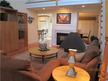 Harwich Cape Cod vacation rental - Living room with view to kitchen and dining room