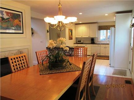 Harwich Cape Cod vacation rental - Dining with fireplace, looking towards kitchen