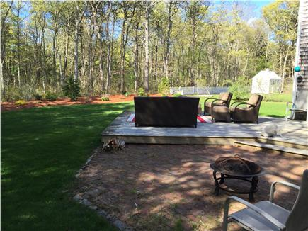 East Falmouth Cape Cod vacation rental - Back deck with gas grill and fire pit