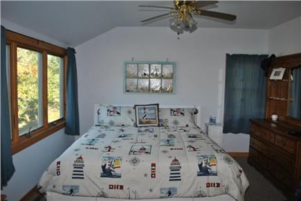 Eastham Cape Cod vacation rental - Master bedroom with king bed, bathroom, and sitting area