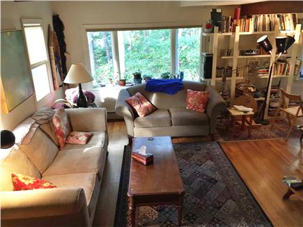 Eastham Cape Cod vacation rental - Open living area leading to a private deck in the trees.