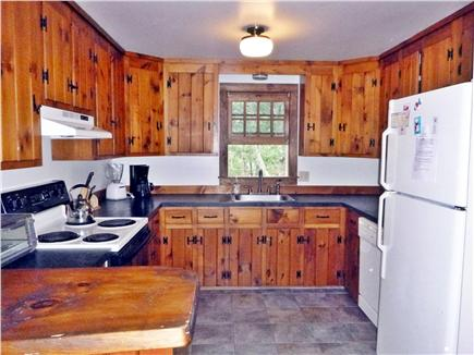 Wellfleet Cape Cod vacation rental - Kitchen with tile floor and knotty pine cabinets