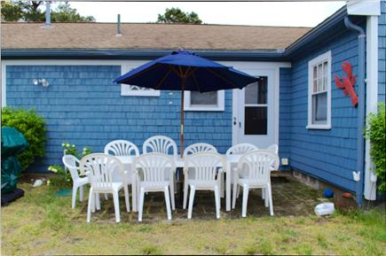 South Yarmouth Cape Cod vacation rental - One of two outside patio areas with grills