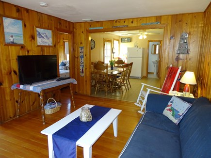 South Yarmouth Cape Cod vacation rental - Living room adjacent to two bedrooms, kitchen and dining area