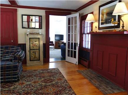 Chatham Cape Cod vacation rental - Living room leads to family room with couches and TV