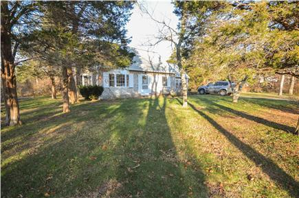Eastham Cape Cod vacation rental - Private large deck and yard surrounded by trees