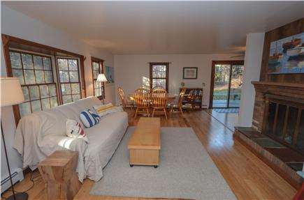 Eastham Cape Cod vacation rental - Spacious living room with fireplace and flat screen TV