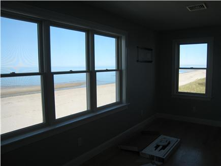 East Sandwich Cape Cod vacation rental - Your view from the front bedroom with a queen bed. TV on wall.