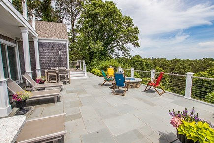 North Chatham, Half a mile to  Cape Cod vacation rental - Back patio with a treetop view down to Chatham harbor