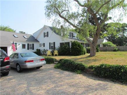 Dennis Port Cape Cod vacation rental - Gravel drive, front yard with screen porch.