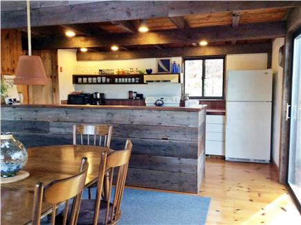 Wellfleet Cape Cod vacation rental - Dining room with sliding glass door to deck and kitchen.