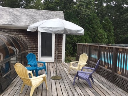Brewster Cape Cod vacation rental - More outdoor seating and fenced in pool area