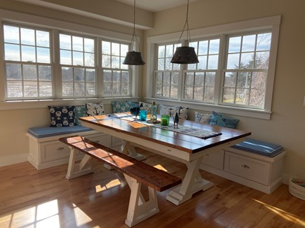 Dennis Cape Cod vacation rental - Dining area with built in bench seating overlooking the Marsh.