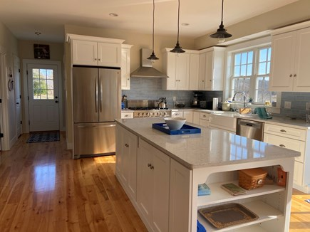 Dennis Cape Cod vacation rental - Kitchen with new appliances, farmers sink and 9 foot island.