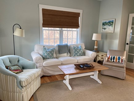 Dennis Cape Cod vacation rental - Family room with TV, couch and two chairs.