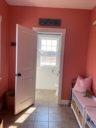 Dennis Cape Cod vacation rental - Mud room with bench seating and plenty of hooks.