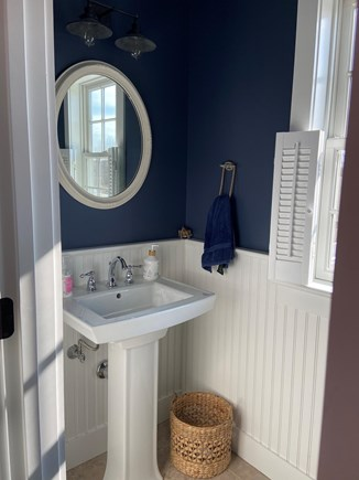 Dennis Cape Cod vacation rental - 1/2 bath with a nautical theme and pedestal sink.
