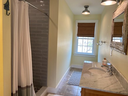 Dennis Cape Cod vacation rental - Master bath with tiled shower and Marble counter top.
