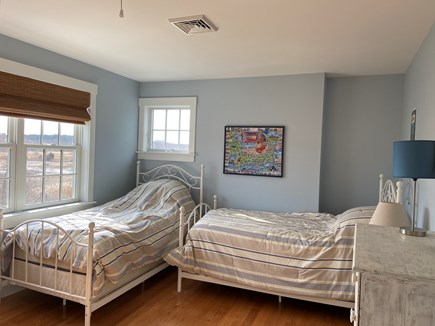 Dennis Cape Cod vacation rental - Bedroom with a view of the Marsh, two beds, closet & dresser.