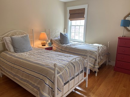 Dennis Cape Cod vacation rental - Bedroom with two beds, closet and a dresser.