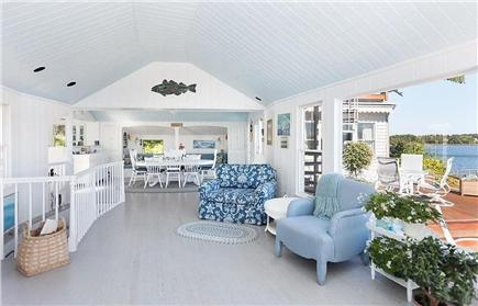 Orleans Cape Cod vacation rental - Living area towards dining room w/views of the deck and water