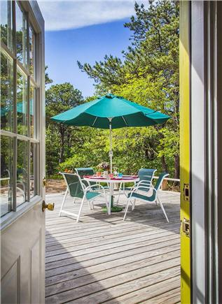 Wellfleet Cape Cod vacation rental - View of large deck with table and umbrella.