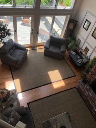 Provincetown Cape Cod vacation rental - Cathedral ceiling living room looking down from bridge