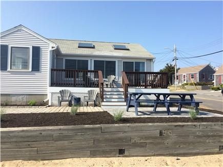 Dennis Port Cape Cod vacation rental - Front of house, new patio, 8' picnic table, 6 Adirondack chairs