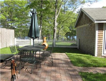 Dennis Cape Cod vacation rental - Patio dining and pond view