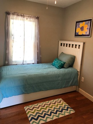 Dennis Cape Cod vacation rental - Kids room trundle (closet shelving for clothes not depicted)