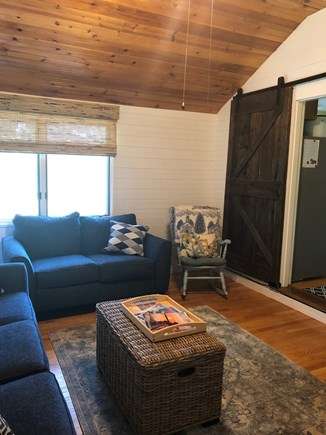 Dennis Cape Cod vacation rental - Family room w/ceiling fan and barn door adds privacy for guests