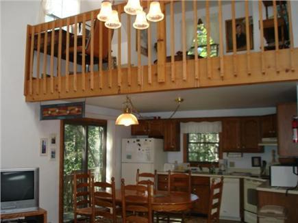 Wellfleet Cape Cod vacation rental - Dining leads to deck. Open den loft above.