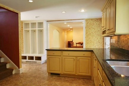 West Yarmouth Cape Cod vacation rental - Kitchen looking into dining room, door goes out to deck