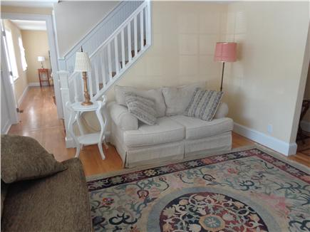 West Yarmouth Cape Cod vacation rental - Living room with hallway to downstairs bedroom