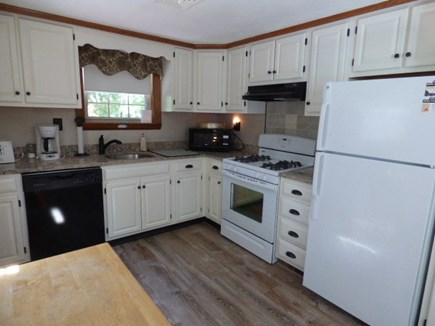 Dennis Cape Cod vacation rental - Kitchen with freshly painted cabinets and new floor