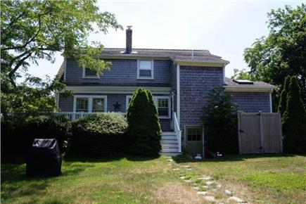 East Orleans Cape Cod vacation rental - House from the back.  Outside shower, deck and grill