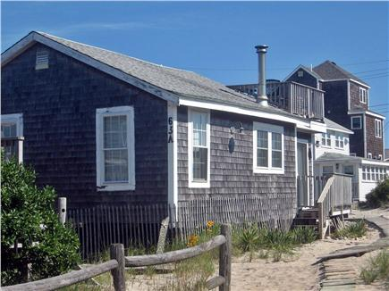 Plymouth MA vacation rental - Warm your toes in sand surrounding the cottage.