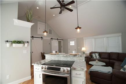West Yarmouth Cape Cod vacation rental - Vaulted ceiling and open floor plan shown from kitchen island.