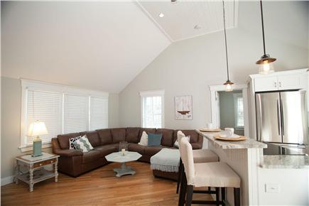 West Yarmouth Cape Cod vacation rental - Spacious living room with leather couch and a nautical flair!