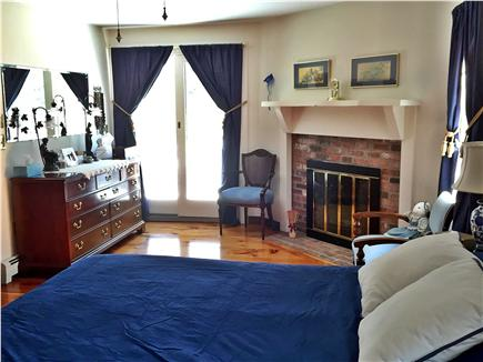 West Yarmouth Cape Cod vacation rental - Master Bedroom with slider to deck and working fireplace