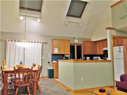 Harwich Cape Cod vacation rental - Kitchen and dining area with vaulted ceilings & skylights