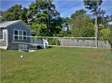 Chatham Cape Cod vacation rental - Back yard - large fully fenced in - irrigation and volleyball net
