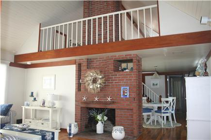 New Seabury, Mashpee New Seabury vacation rental - Open living room with chimney & loft perspective