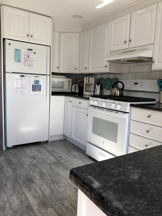 Dennisport Cape Cod vacation rental - Full kitchen with gas range, microwave, dishwasher